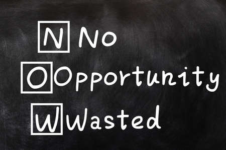 wasted: Acronym of NOW for No Opportunity Wasted written on a blackboard