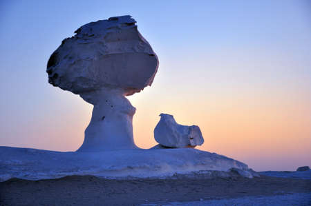 Landscape of the famous white desert in Egypt at sunrise photo