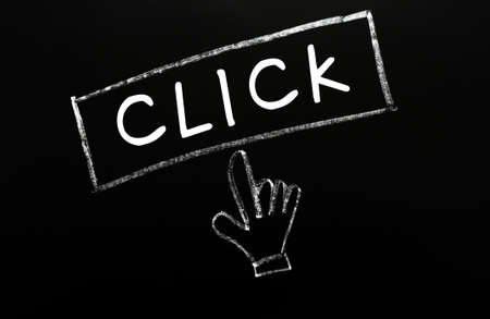 Click - button with a cursor hand drawn on a blackboard photo