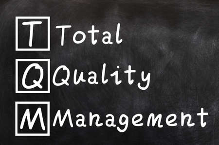 Handwriting of Total Quality Management  TQM  concept for business and industry photo