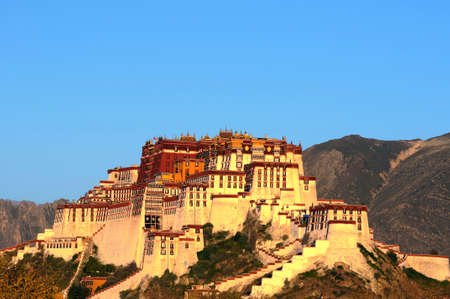 potala: Landmark of the famous historic Potala Palace in Lhasa Tibet at sunrise Editorial