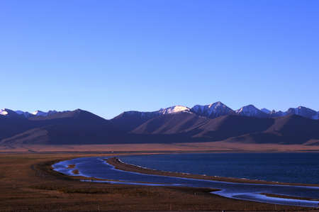 Landscape of mountains and lakes in the highlands of Tibet photo