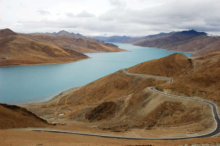 Landscape at the lakeside of Yamdrok Lake in Tibet photo