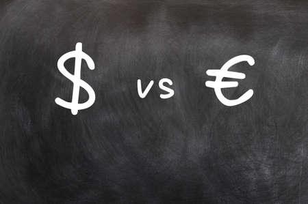 Dollar vs Euro - symbols written with chalk on a blackboard Stock Photo - 13787426