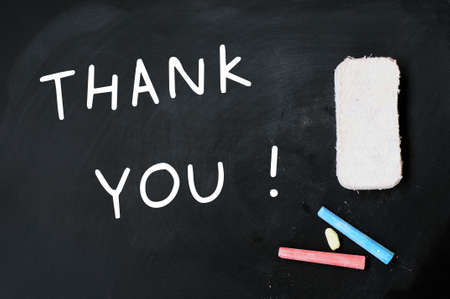 Thank you written on a blackboard, with eraser and chalk photo