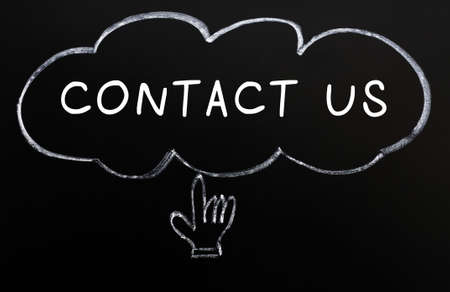 Contact us with a hand cursor drawn in chalk on a blackboard photo