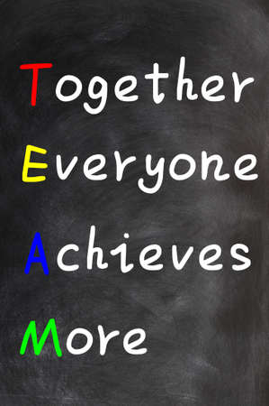 Acronym of TEAM for Together Everyone Achieves More on a blackboard background photo