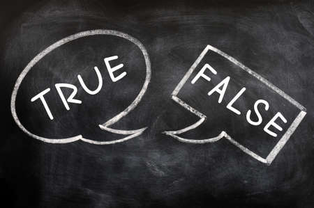 true false: Two speech bubbles drawn with chalk on a blackboard for True and False