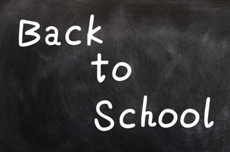blankness: Back to school written with white chalk on a blackboard Stock Photo