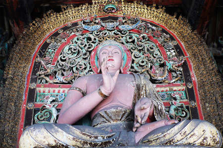 The famous mud sculpture of buddha at the Shuanglin temple in Pingyao,Shannxi,China photo