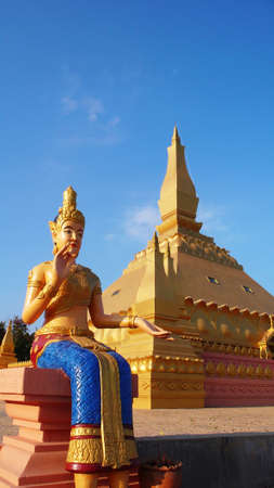 lao: Landmark of famous historic golden Buddha sculpture and temple in Laos Editorial