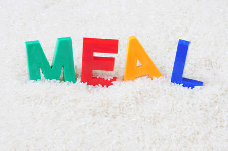 paddy field: Meal - word made of colorful plastic letters in the rice