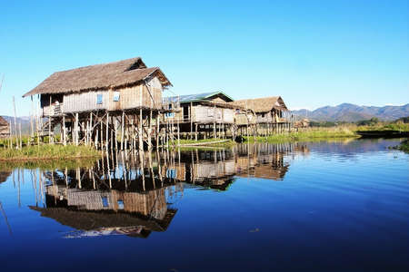 inle: Landscape of wooden houses built in water in Myanmar Stock Photo