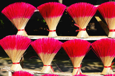 Red incense or joss sticks for buddhist prayers in Vietnam  photo