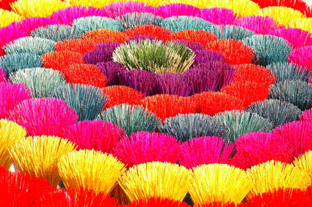 buddhism prayer belief: Colorful incense or joss sticks for buddhist prayers in Vietnam