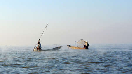 inle: Fishermen fishing in a lake in Myanmar at sunrise