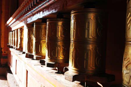 Golden Tibetan prayer wheels in a lamasery Stock Photo - 13963914