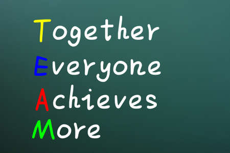 everyone: Team acronym for together everyone achieves more written with chalk on a green board