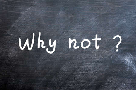 Why not - question written with white chalk on a blackboard photo