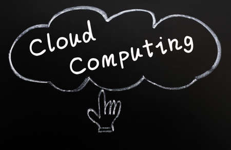 Cloud computing concept with a hand cursor drawn in chalk on a blackboard photo