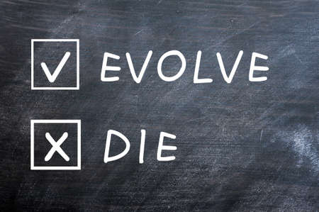 evolve: Evolve or die with check boxes drawn with chalk on a smudged blackboard