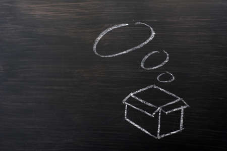 Concept of Think Outside the box, drawn with chalk on a blackboard  Stock Photo