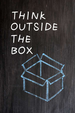 Concept of  Think outside the box  drawn with chalk on a blackboard  Stock Photo - 14063102