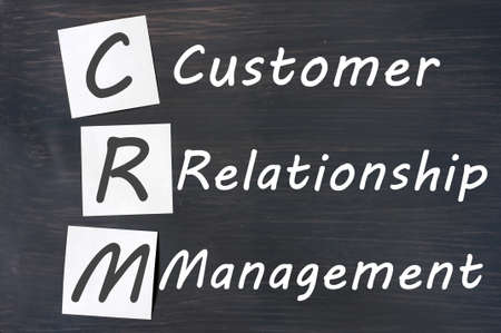 Acronym of CRM - Customer Relationship Management written on a blackboard Stock Photo