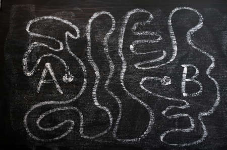 shortcut: A maze of long way from A to B drawn with white chalk on a blackboard Stock Photo
