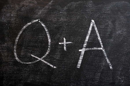Question and Answer - symbols drawn with chalk on a smudged blackboard photo