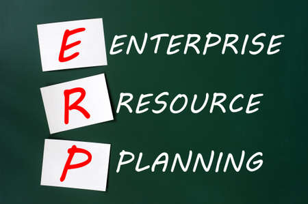 Chalk drawing of ERP acronym for Enterprise Resource Planning on a green chalkboard photo