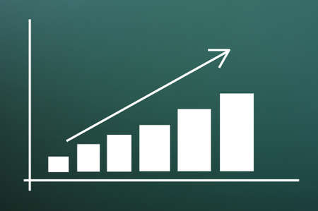 Business chart of growth drawn on a blackboard background photo