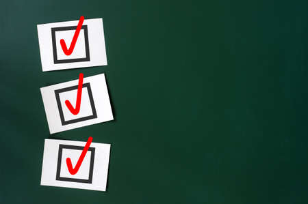 wood tick: Check box with red tick on a green chalkboard, with copy space for text