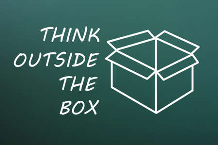 Concept of Think Outside the box drawn with chalk on a green chalkboard  photo
