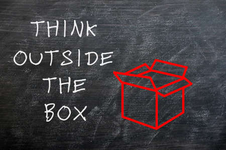 Concept of Think Outside the box drawn with chalk on a smudged chalkboard  photo