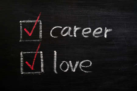 love life: Love and career choices with check boxes drawn with chalk on a blackboard