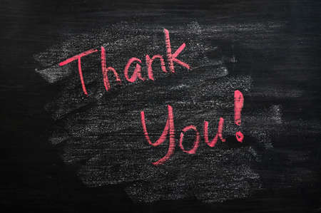 Thank you written with red chalk on a smudged blackboard Stock Photo - 14198793