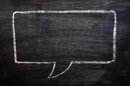 chalk: Blank speech bubble drawn with chalk on a smudged blackboard background for text writing and design