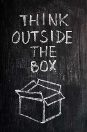 open brain: Concept of Think Outside the box drawn with chalk on a smudged blackboard