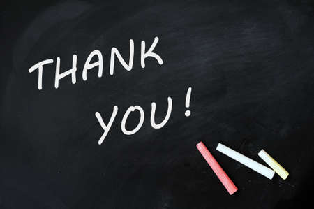 grateful: Thank you written with white chalk on a smudged blackboard