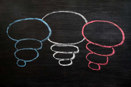 Blank speech bubbles drawn with color chalk on a blackboard  Stock Photo - 14198852