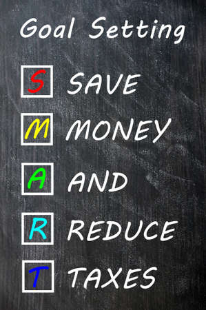 Smart goal setting concept on blackboard for save money and reduce taxes photo