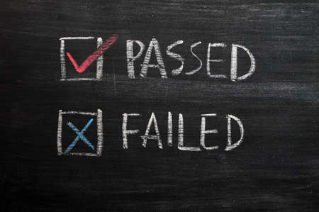 multiple choice: Check boxes for passed and failed with tick and cross on a smudged blackboard Stock Photo