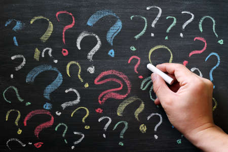 Question marks on chalkboard. Decision, confusion, FAQ or other concept. Hand writing with chalk on school black board.  Stock Photo - 14287492