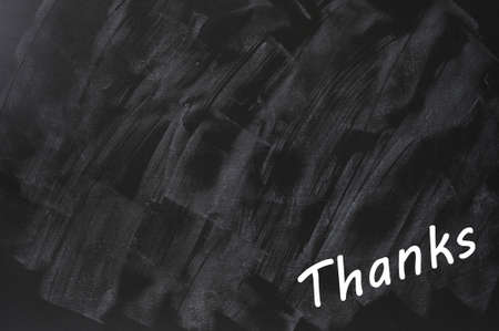 Thanks written on a smudged blackboard background with copy space for text and design Stock Photo - 14287493