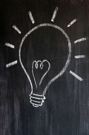 Light bulb drawn on a smudged blackboard  photo