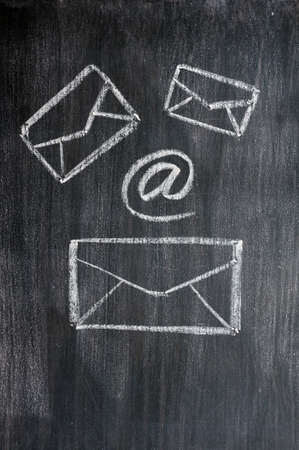 Chalk drawing of email symbols on a blackboard  Stock Photo