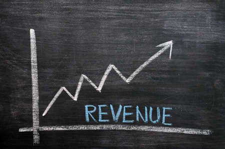 profit graph: Chart of revenue growth drawn with chalk on a chalkboard Stock Photo