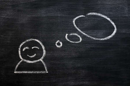 Blank speech bubble with a cartoon figure drawn on a blackboard background Stock Photo - 14309713
