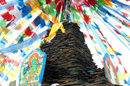 mani: Tibetan prayer flags and mani rocks in a lamasery Stock Photo